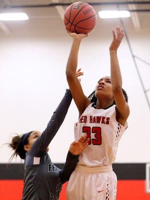 Stewarts Creek's Zhordan Shannon (33) scored 16 points in the Lady Red Hawks' win over Rossview Friday.