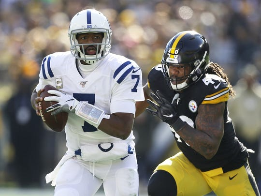 Nov 3, 2019; Pittsburgh, PA, USA;  Indianapolis Colts quarterback Jacoby Brissett (7) runs with the ball as Pittsburgh Steelers outside linebacker Bud Dupree (48) chases during the first quarter  at Heinz Field. Mandatory Credit: Charles LeClaire-USA TODAY Sports