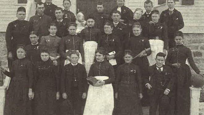 Students and staff at Scattergood Friends School posed for a photo during the school's first year in 1890-91.