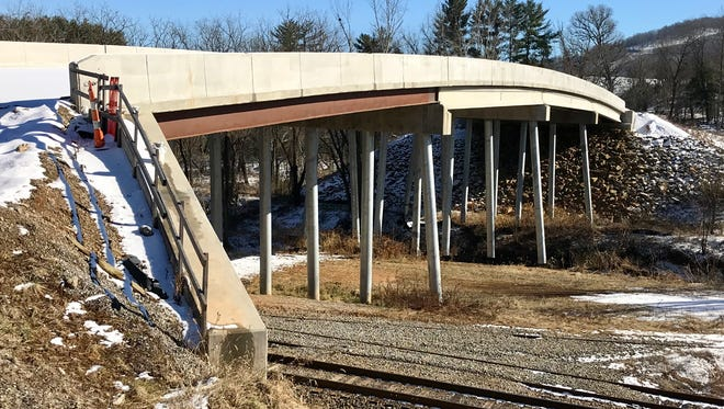 The $3.5-million bridge leading to the proposed Enka Center site is largely completely. The N.C. DOT says it has no plans to fund a road leading to it.