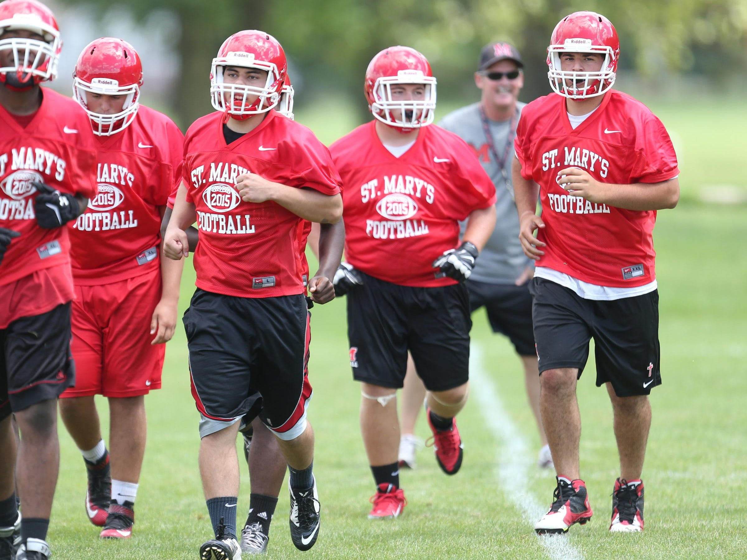 Orchard Lake St. Mary's high school football players go through drills during practice on Tuesday, August 11, 2015 in Orchard Lake Michigan.