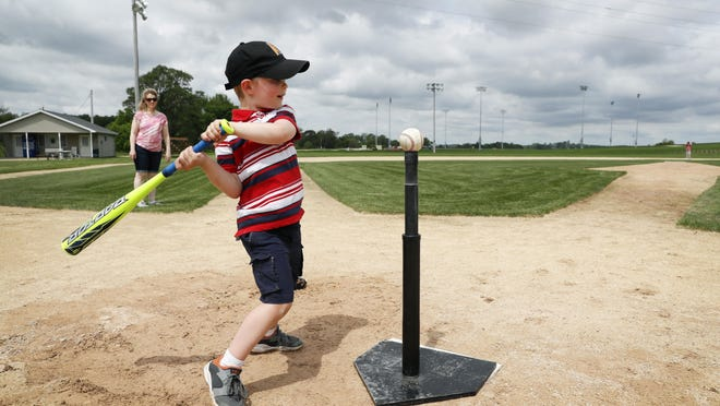 Four-year-old David Bronson, of Ames, Iowa, hits a ball off a tee on the field at the Field of Dreams movie site, Friday, June 5, in Dyersville, Iowa. Major League Baseball is building another field a few hundred yards down a corn-lined path from the famous movie site in eastern Iowa but unlike the original, it's unclear whether teams will show up for a game.