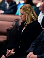 Mayor-Elect Megan Barry bows her head during a prayer