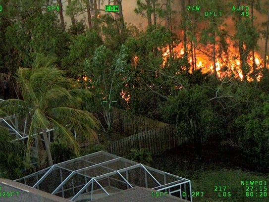 A wildfire burned at the western edge of a Port St.