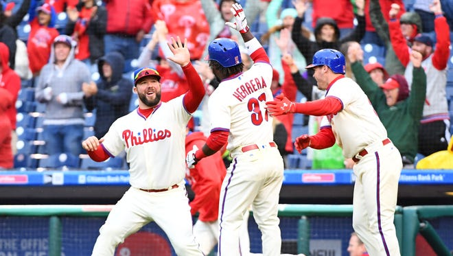 Odubel Herrera celebrates after scoring the winning run in the 10th inning against the Nationals.