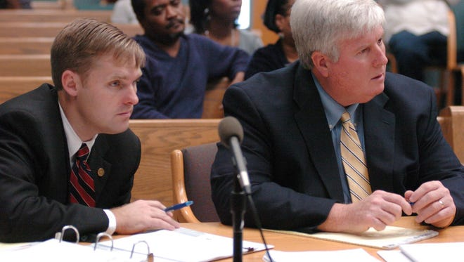 Madison County District Attorney Michael Guest (left) and Assistant District Attorney John Emfinger in 2008.