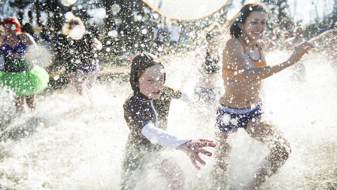 Hundreds braved the cold waters at Willow Springs Park to participate in the annual Polar Bear Plunge that benefits Developmental & Disability Services Lebanon Valley on Jan. 1, 2017.