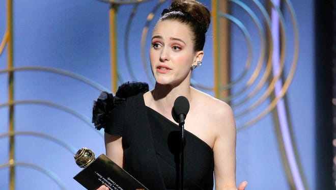 """Rachel Brosnahan accepts her Golden Globe for best actress in a comedy series or musical for her role in """"The Marvelous Mrs. Maisel."""""""