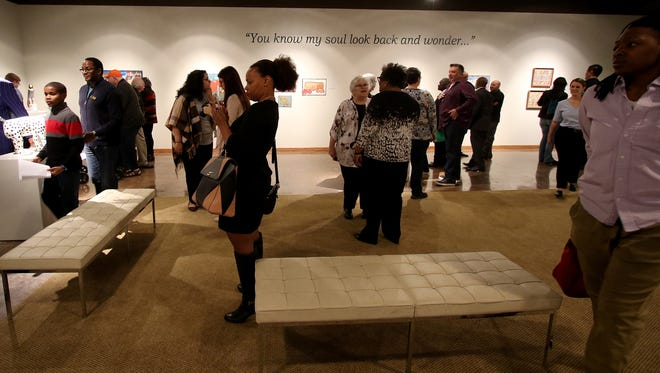 """Visitors view artwork at the """"The Souls of Black Folk"""" exhibition Sunday, Feb. 4, 2018, at the Wichita Falls Museum of Art at Midwestern State University."""