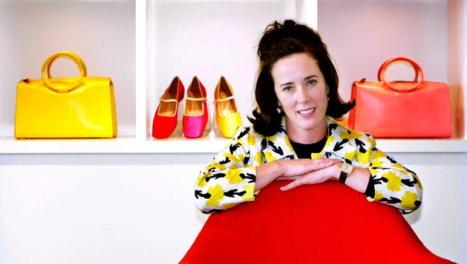 Designer Kate Spade poses with handbags and shoes from her collection in New York.