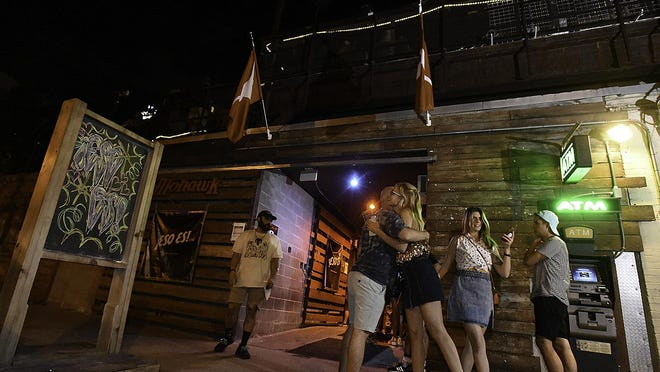 """Music fans embrace outside of Mohawk in August 2019. The Red River Street music venue in downtown Austin has been closed during the pandemic, along with most other live music venues. Owner James Moody says grant money in a new coronavirus relief bill """"could mean all the difference in the world."""""""
