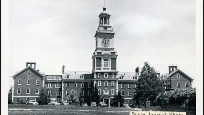 This image from the Topeka State Journal archives shows the Menninger property and clock tower when it was still in use. The current owner of the property is pursuing plans to demolish the clock tower, as the costs of maintaining it have become too high.