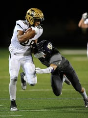 Abilene High running back Abram Smith (28) shoves away a Keller Timber Creek defender during a 2016 game at the Keller Athletic Complex. Smith, now at Baylor, has not played in a game since the playoffs that season.