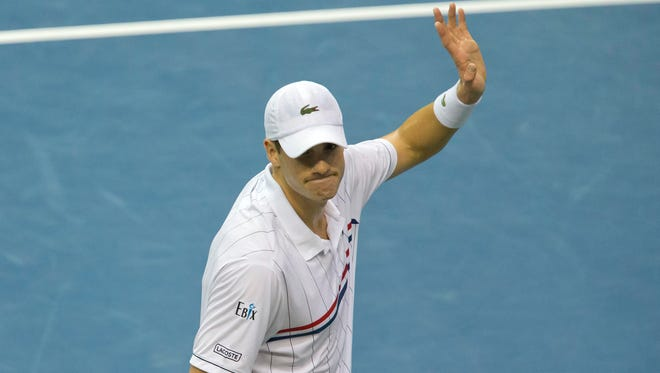 John Isner (USA) celebrates recording match point in his Davis Cup match against Lukas Lacko (SVK) at the Sears Centre Arena.