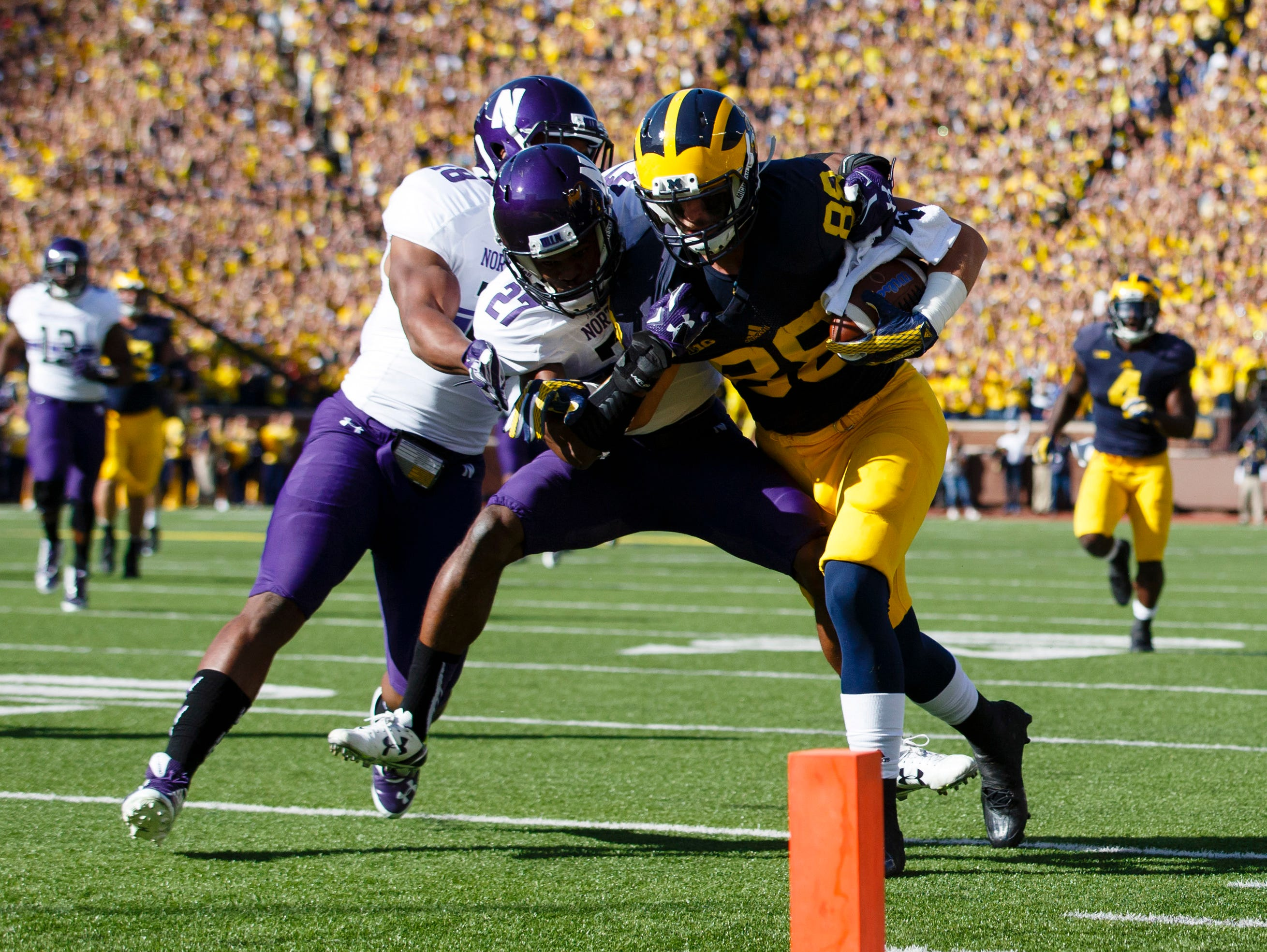 Oct 10, 2015; Ann Arbor, MI, USA; Michigan Wolverines tight end Jake Butt (88) is tackled just short of the end zone by Northwestern Wildcats cornerback Matthew Harris (27) in the first quarter at Michigan Stadium.