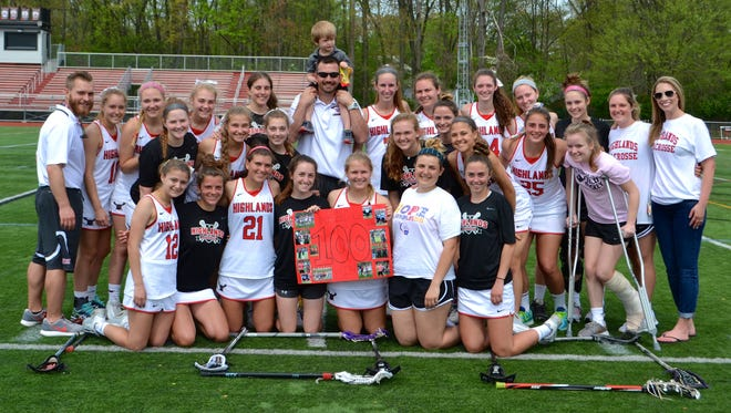 Coach Michael Menzella (middle) and the Northern Highlands girls lacrosse team celebrate after Saturday's victory.