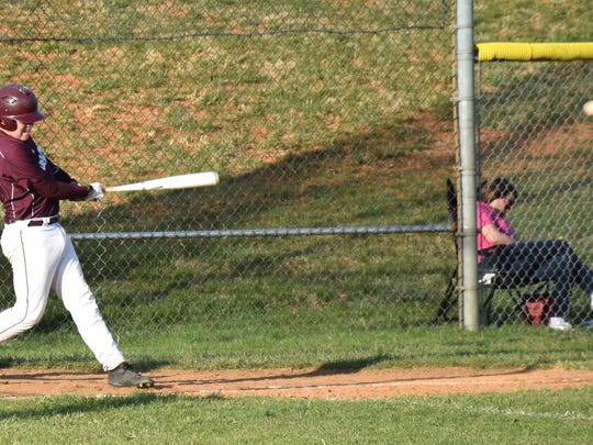Stuarts Draft's Easton Martin strokes a single to left field during the second inning of the Cougars' nondistrict game against Waynesboro on Monday, April 10, 2017, at Stuarts Draft High School.