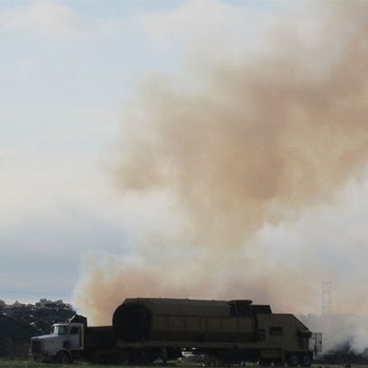 Smoke rises from a fire at Rolling Hills landfill Friday