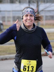 Jennifer Brady gives a thumbs up while running in the
