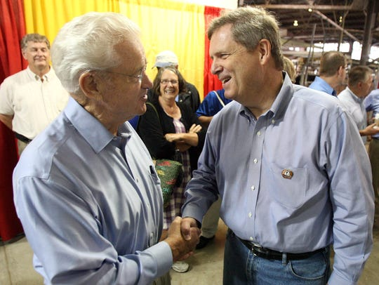 Then-U.S. Agriculture Secretary Tom Vilsack, right, greets then-Congressman Leonard Boswell before an agriculture town hall meeting Wednesday morning, Aug. 19, 2009 at the Iowa State Fair. ( Christopher Gannon/The Register)