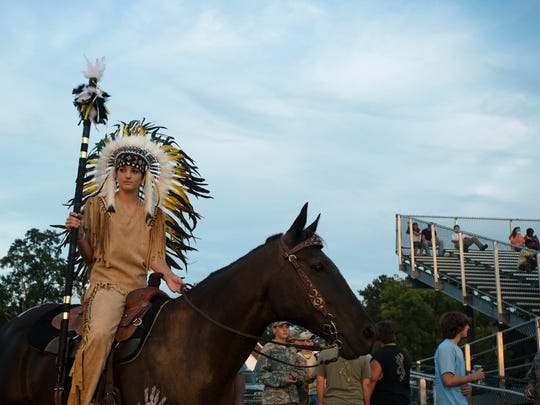 The Wetumpka indians mascot waits to take the field before the game between Wetumpka and Huffman in Wetumpka, Ala., on Friday, Aug. 29, 2014.