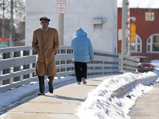 Warren Howard, of Port Huron, crosses the Seventh Street