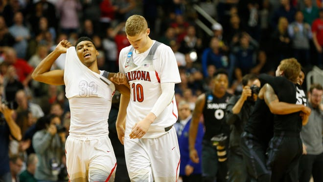 Arizona guard Allonzo Trier (35) and Arizona forward Lauri Markkanen (10) react after losing to Xavier in the NCAA West Regional at SAP Center in San Jose, Calif. March 23, 2017. Arizona lost 73-71.