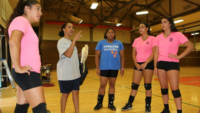 Alicia Murray, second from left, greets returning volleyball players at Yonkers Middle High School, Aug, 25, 2016. Murray was away from coaching for a while, but has now returned.