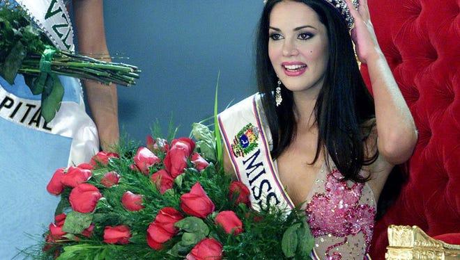 Venezuelan Monica Spear poses after being elected Miss Venezuela in Caracas on Sept. 23, 2004.