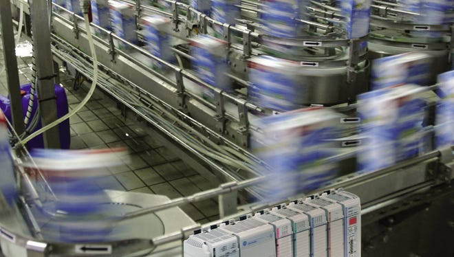 Rockwell Automation, which makes factory automation systems, predicts its first annual sales increase in three years.