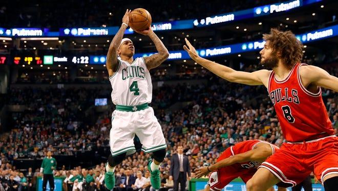 Boston Celtics guard Isaiah Thomas (4) shoots over Chicago Bulls center Robin Lopez (8) during the second quarter at TD Garden.