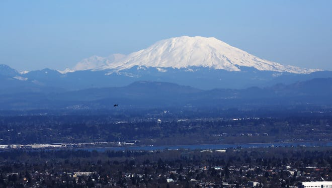 The Fremont Bridge with the Columbia River, Mount St. Helens and Mount Rainier beyond to the north.