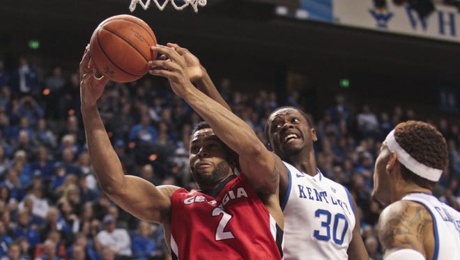 Kentucky's Julius Randle gets outrebounded by Georgia's Marcus Thornton for this ball Saturday afternoon at Rupp Arena in Lexington. The Bulldogs outrebounded the Wildcats 35-32 but UK still easily won 79-54.