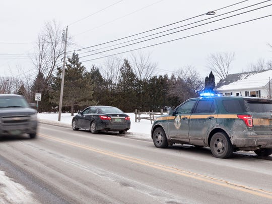 Vermont State Trooper Jay Riggen makes a stop on U.S. 7 in Swanton on Friday, Dec. 15, 2017.