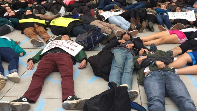 """Students from Hastings High School who demanded justice for the death of Eric Garner staged a """"die-in"""" outside of the school on Dec. 5., 2014. (file photo)"""
