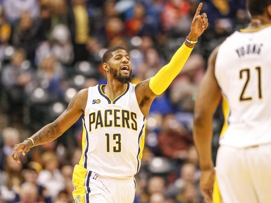 Indiana Pacers forward Paul George (13) signals to