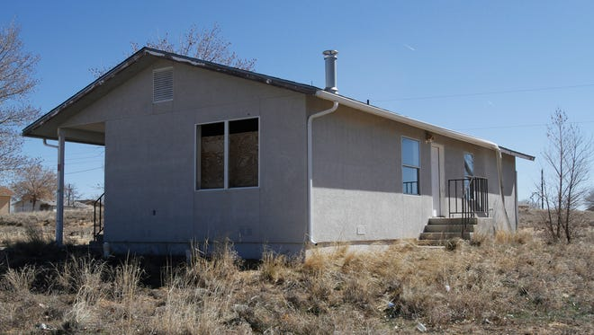 An unoccupied home in the Bluffview Housing Community, a Navajo Housing Authority neighborhood located south of Farmington, is pictured on Friday. Many of the community's residents say they were not familiar with an NHA policy that requires all members of a household that is involved in a domestic violence incident to be evicted. DNA People's Legal Services is suing the tribal agency to discontinue the policy.