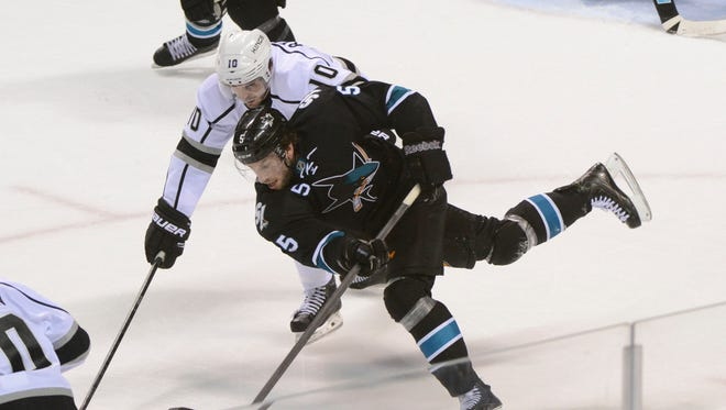 San Jose Sharks defenseman Jason Demers (5) controls the puck against Los Angeles Kings center Mike Richards (10) during the second period in game seven.