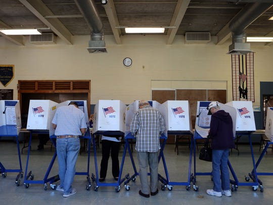 Voters cast their ballot at Street Community Center