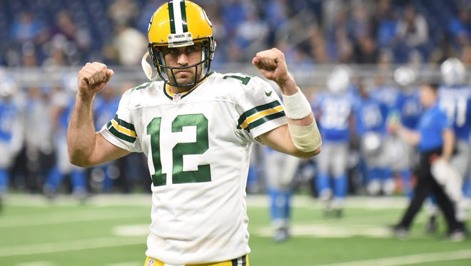 Packers quarterback Aaron Rodgers flexes towards the Packers fans near the end of the game.
