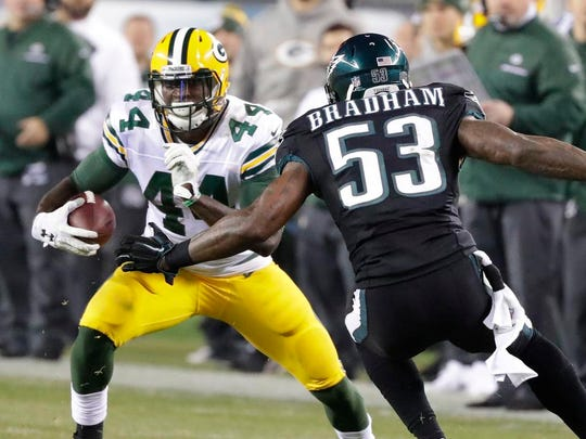 Green Bay Packers running back James Starks (44) tried to cut around defender outside linebacker Nigel Bradham (53) against the Philadelphia Eagles at Lincoln Financial Field.