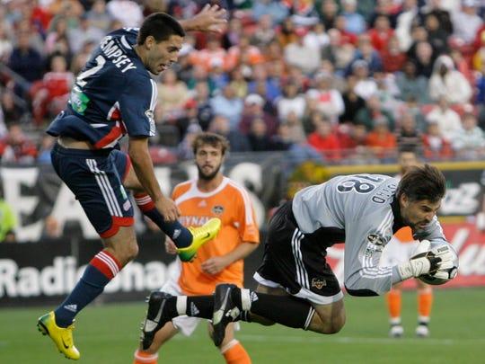 Houston Dynamo goalkeeper Pat Onstad goes flying after