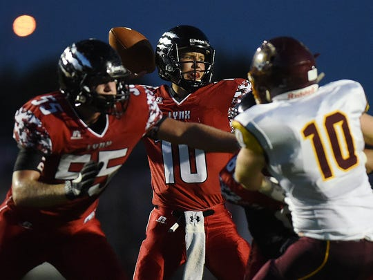 Brandon Valley's Alex Waltner throws a pass while teammate