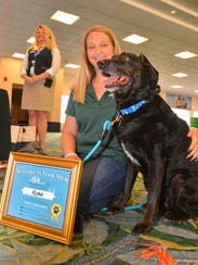 """Kuma, the 10-year-old black lab, became the first and only """"ambassadog"""" in the nation at the Orlando Melbourne International Airport."""