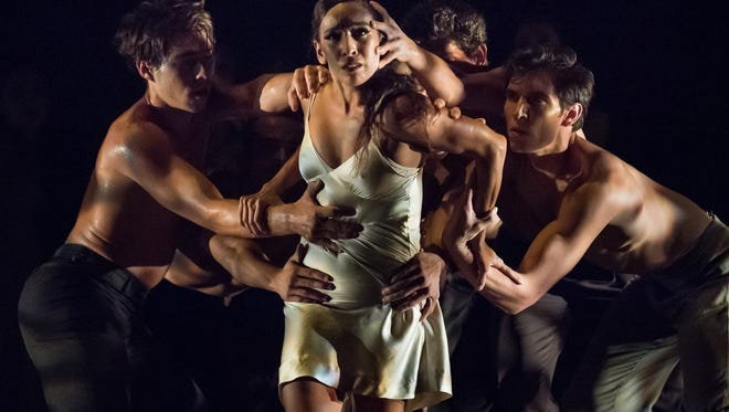 """Senior soloist Maizyalet Velázquez is seen during a particularly harrowing moment in choreographer Travis Wall's """"Then ... Now."""""""