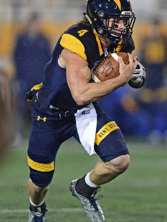 File-This Nov. 8, 2016, file photo shows Kent State quarterback Nick Holley (4) running in the first quarter of an NCAA college football game in Kent, Ohio. Good players can get lost on bad teams, but here are a few who will be worth seeking out in 2017. Just don't wait until bowl season because it will probably be too late. (AP Photo/David Dermer, File)