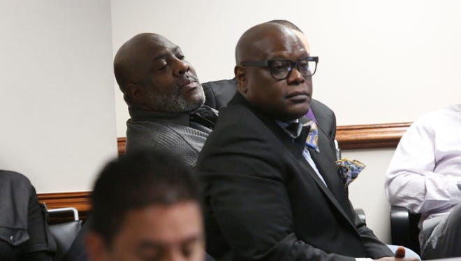 Stanley Ridley peers over Damon Jones shoulders during a public safety committee meeting at the Westchester County Office building in White Plains on Feb. 7, 2017.  Ridley is the father of Christopher Ridley, a Mount Vernon Police Officer who was killed by a Westchester County Police Officer.