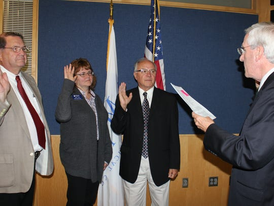 From left: The Moraine Park District Board swears in Lowell Prill of Brandon, Judy Lux of Fond du Lac and Mike Miller of West Bend.