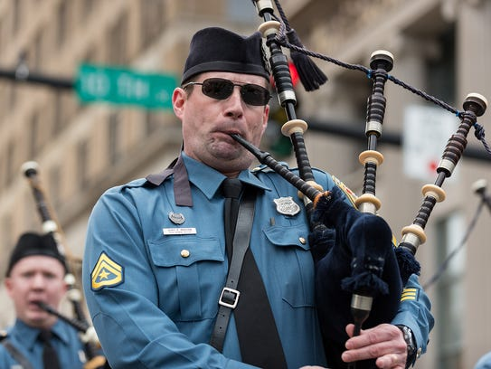 The Delaware State Police Pipe and Drums march in the