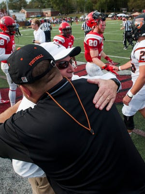 Huntingdon Head Coach Mike Turk hugs Hendrix Head Coach Buck Buchanan after the NCAA Div. III Playoffs first round game at the Huntingdon campus in Montgomery, Ala. on Saturday November 21, 2015.